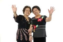 Asian senior women. Senior asian woman waving and saying hallo stock photography