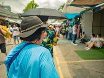Asian Senior women Shopping in Chatuchak Weekend Market Bangkok royalty free stock photography