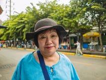 Asian Senior women Shopping in Chatuchak Weekend Market Bangkok. Asian Senior woman Shopping in Chatuchak Weekend Market Bangkok Thailand royalty free stock photography
