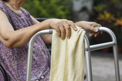 Asian senior women sit and hold a walker Royalty Free Stock Images