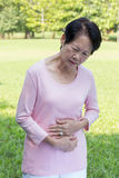 Asian senior women stomachache. Portrait of Asian senior woman stomachache Royalty Free Stock Images