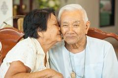 Free Asian Senior Womman Kissing Senior Man Stock Photos - 84201973