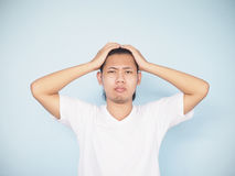 Asian serious young man worry and get headache. Royalty Free Stock Photo
