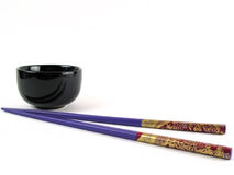 Asian set. Little bowl and sticks Royalty Free Stock Photos
