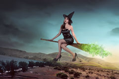 Asian sexy witch woman ride the broom Stock Photos