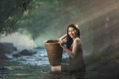Asian sexy woman bathing in cascade Stock Photos