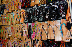 Asian Shoes. A wall full of wooden asian style flip-flops on a vietnamese market Royalty Free Stock Image