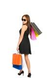 Asian Shopper Walking Away Looking Over Shoulder Stock Photo