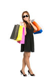 Asian Shopping Bags Over Shoulders Full At Camera Stock Images