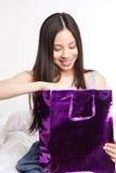 Asian shopping girl. A shot of a beautiful asian girl carrying a shopping bag royalty free stock images