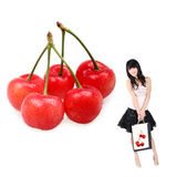 Asian shopping girl and cherry. Asian shopping girl and fresh cherry on white Royalty Free Stock Photography