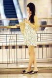 Asian shopping girl texting stock image