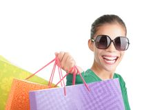 Asian shopping woman. Shopping. Excited woman shopper with a big grin and a lot of shopping bags. Isolated on white background Stock Image