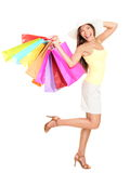 Asian Shopping woman happy. Smiling holding many shopping bags. Asian shopper girl isolated on white background in full length wearing summer hat Stock Photography