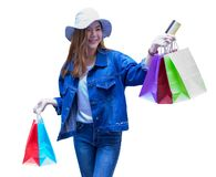 Asian shopping woman holding credit or debit card and shopping bags isolated on white background.. Consumerism, lifestyle, sale stock photography