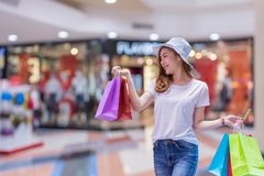 Asian shopping woman holding credit or debit card and shopping bags at shopping mall. Consumerism, sale and people online concept.  stock images