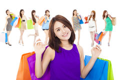 Asian shopping women group holding color bags. isolated on white royalty free stock images