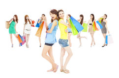 Asian shopping women group holding color bags. Royalty Free Stock Images