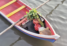 Asian shopping on wooden boat Stock Images