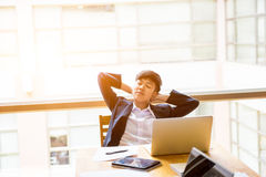 Asian short black hair tomboy business with two hand on head sit. In front of laptop and close her eyes Stock Images