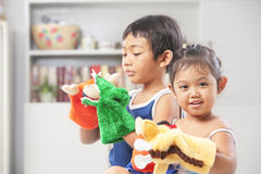 Asian sibling playing hand puppet Royalty Free Stock Photography