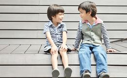 Asian sibling sitting together with smile Stock Photos