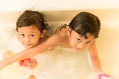 Asian Siblings Happy Playing Toys in The Bathtub Stock Images