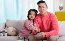 Asian siblings with puppets Royalty Free Stock Images
