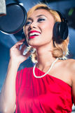 Asian singer producing song in recording studio Royalty Free Stock Photography