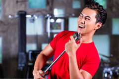 Asian singer producing song in recording studio Stock Photography