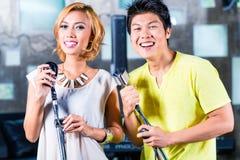 Asian singer producing song in recording studio. Asian professional musician recording new song or album CD in studio Stock Photo