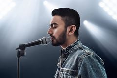 Asian singer singing with microphone. Asian singer sing with microphone stock images