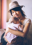 Asian single mom and daughter. Asian women hold tight her daughter, looks sad. Vintage retro style photo with color filters, vignette effect, and some fine film Stock Images