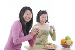 Asian sisters dining Royalty Free Stock Photography