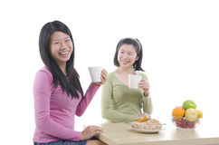 Asian sisters dining Royalty Free Stock Images