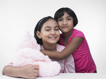Asian sisters with teddy bear Stock Images