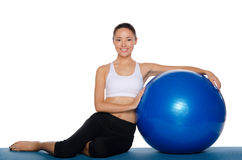 Asian sits with blue ball Stock Photo