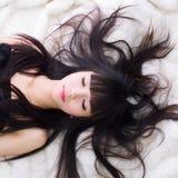 Asian sleep girl. Asian girl with black hair Stock Images