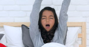 Asian sleepy young cute girl with tousled hair rest on bed at home stock footage