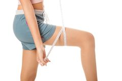 Asian slim girl measuring her leg with  tape Royalty Free Stock Photos