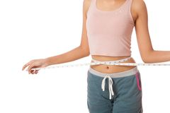 Asian slim girl measuring her waist with  tape Stock Photos