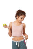 Asian slim girl with measuring tape and green apple Stock Photography