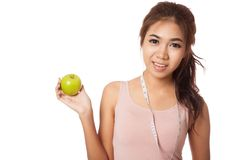 Asian slim girl with measuring tape and green apple Royalty Free Stock Images