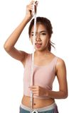 Asian slim girl with measuring tape Royalty Free Stock Photography