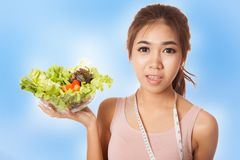 Asian slim girl with measuring tape and salad Stock Photo