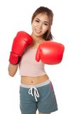 Asian slim girl punch with red  boxing glove Royalty Free Stock Photography