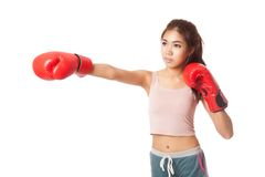Asian slim girl punch with red  boxing glove Royalty Free Stock Photo