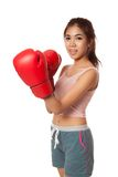 Asian slim girl  with red  boxing glove Royalty Free Stock Image