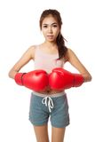Asian slim girl  with red  boxing glove Royalty Free Stock Photo