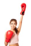 Asian slim girl win the fight with red boxing glove. Isolated on white background royalty free stock photos